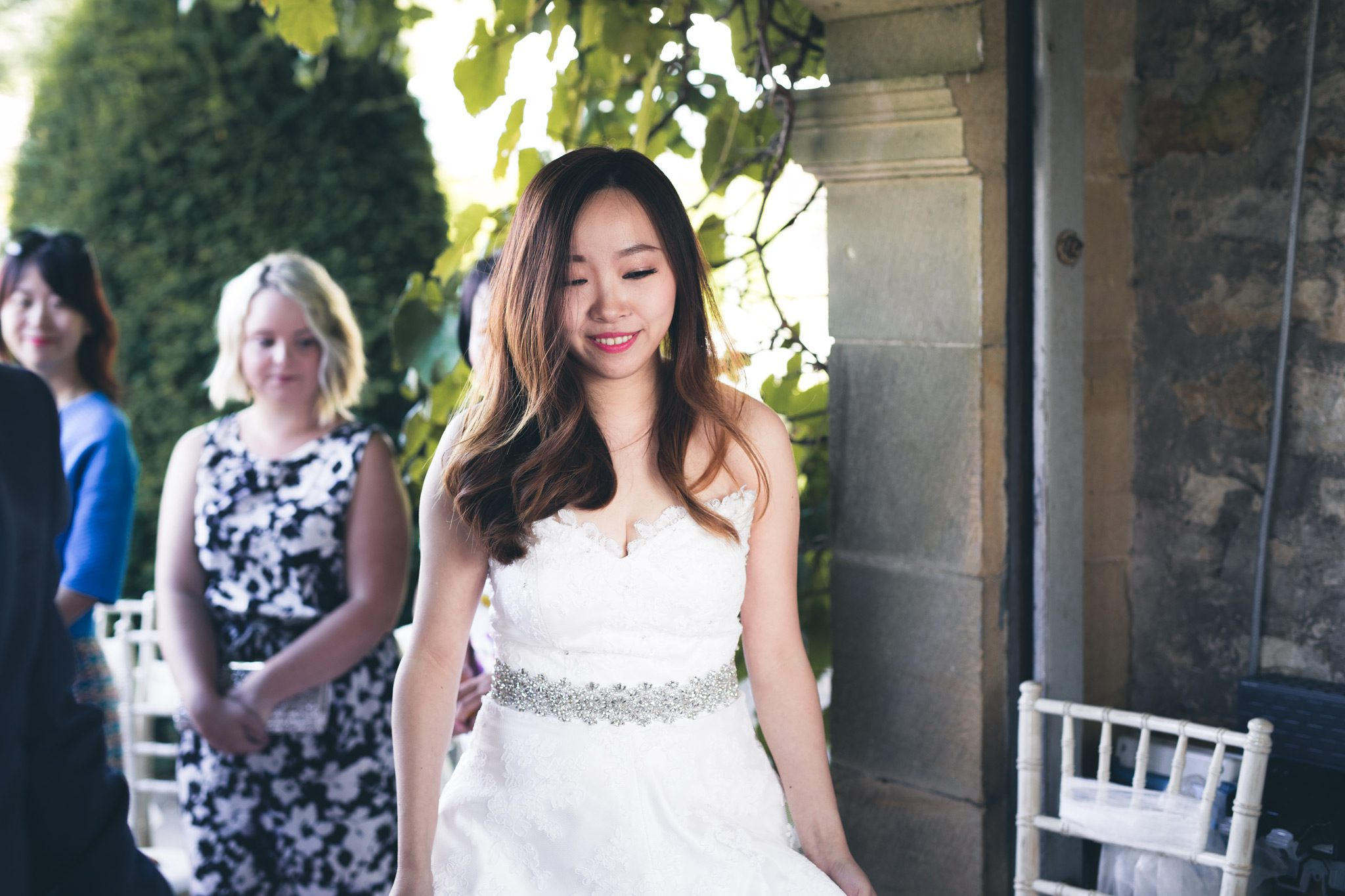 Summer Wedding at Haddon Hall - Xianxi arriving to the service