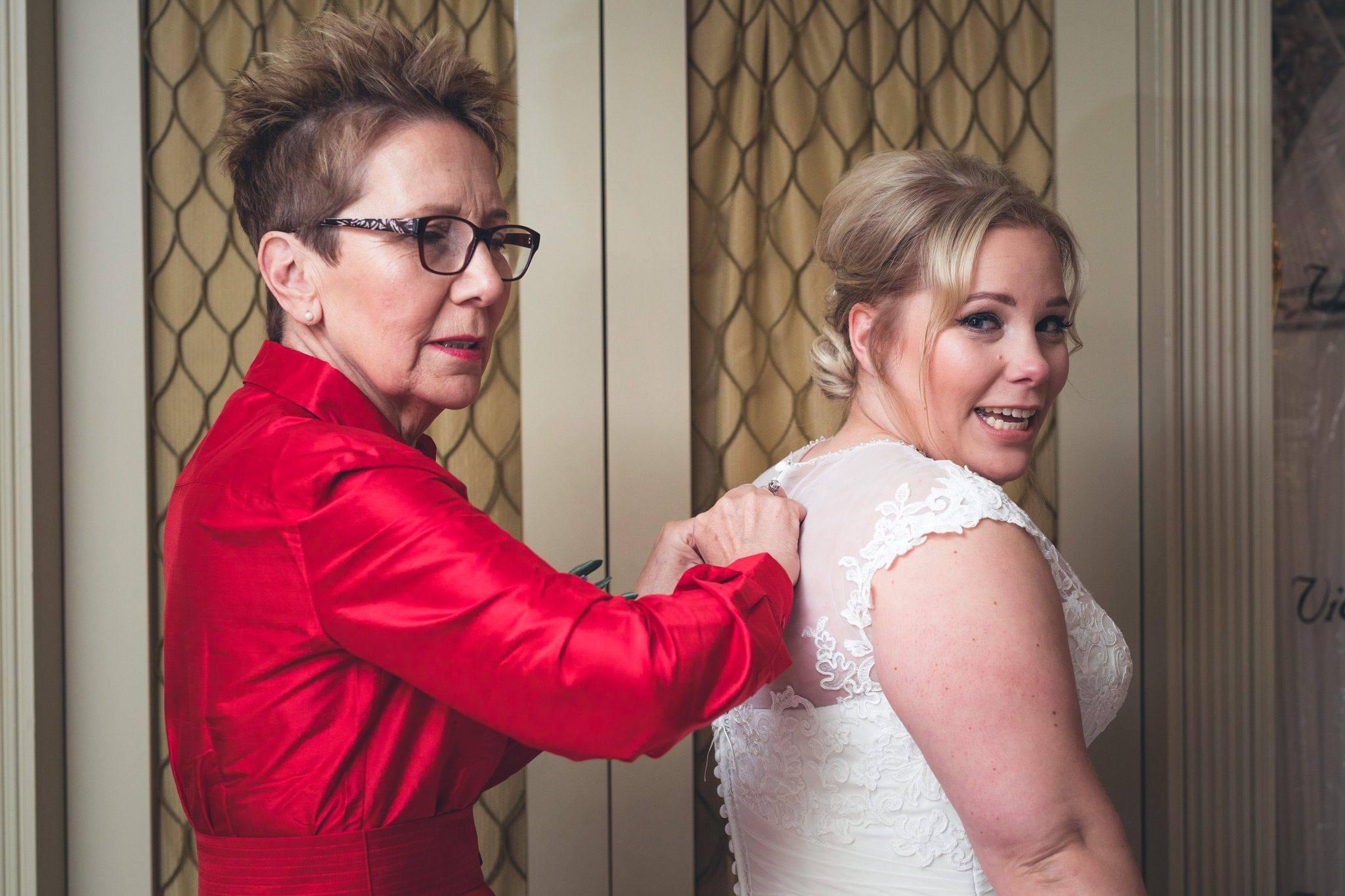 Bride and Mother Getting in the Dress