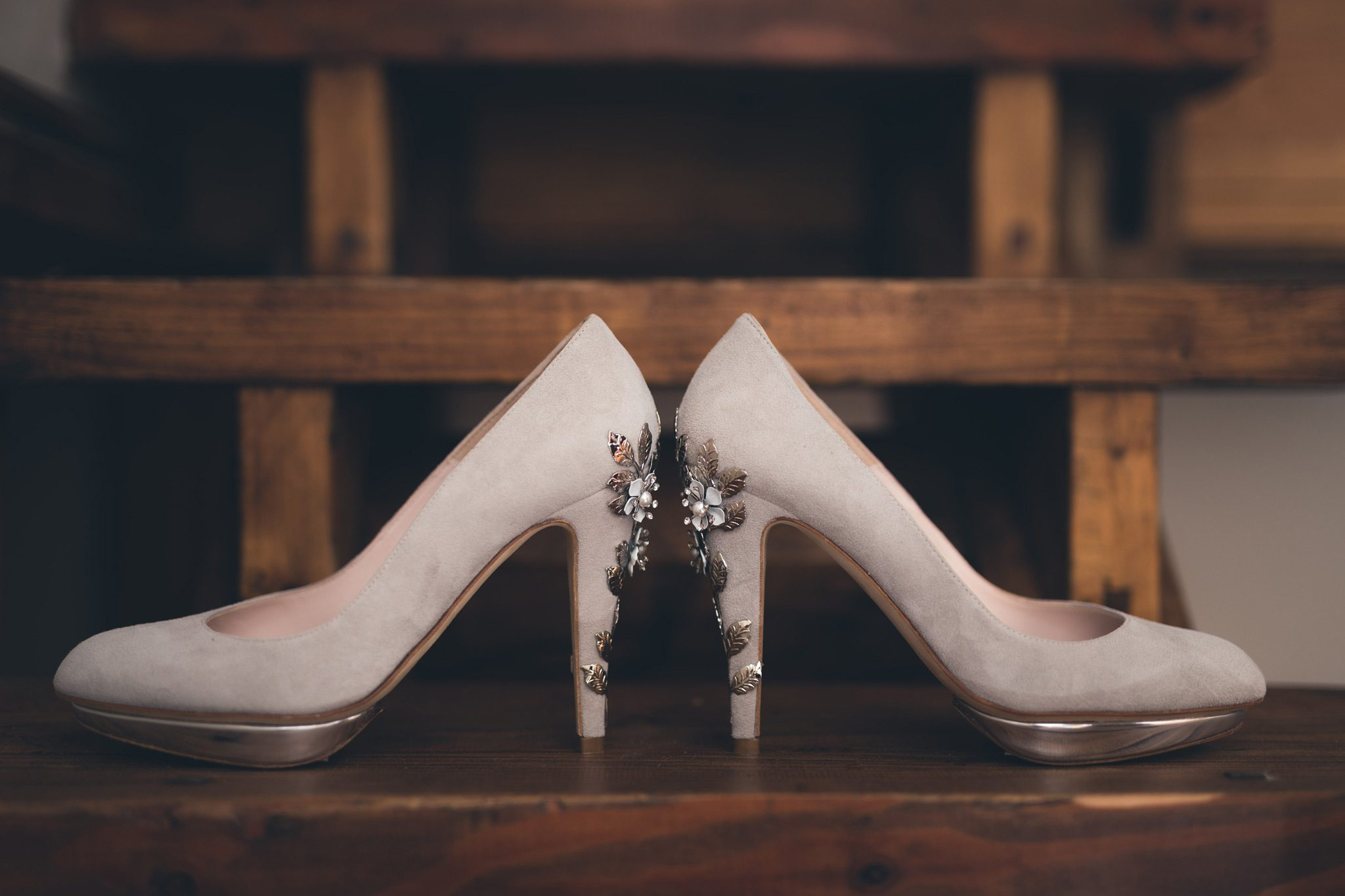 Gorgeous wedding shoes on wooden stairs