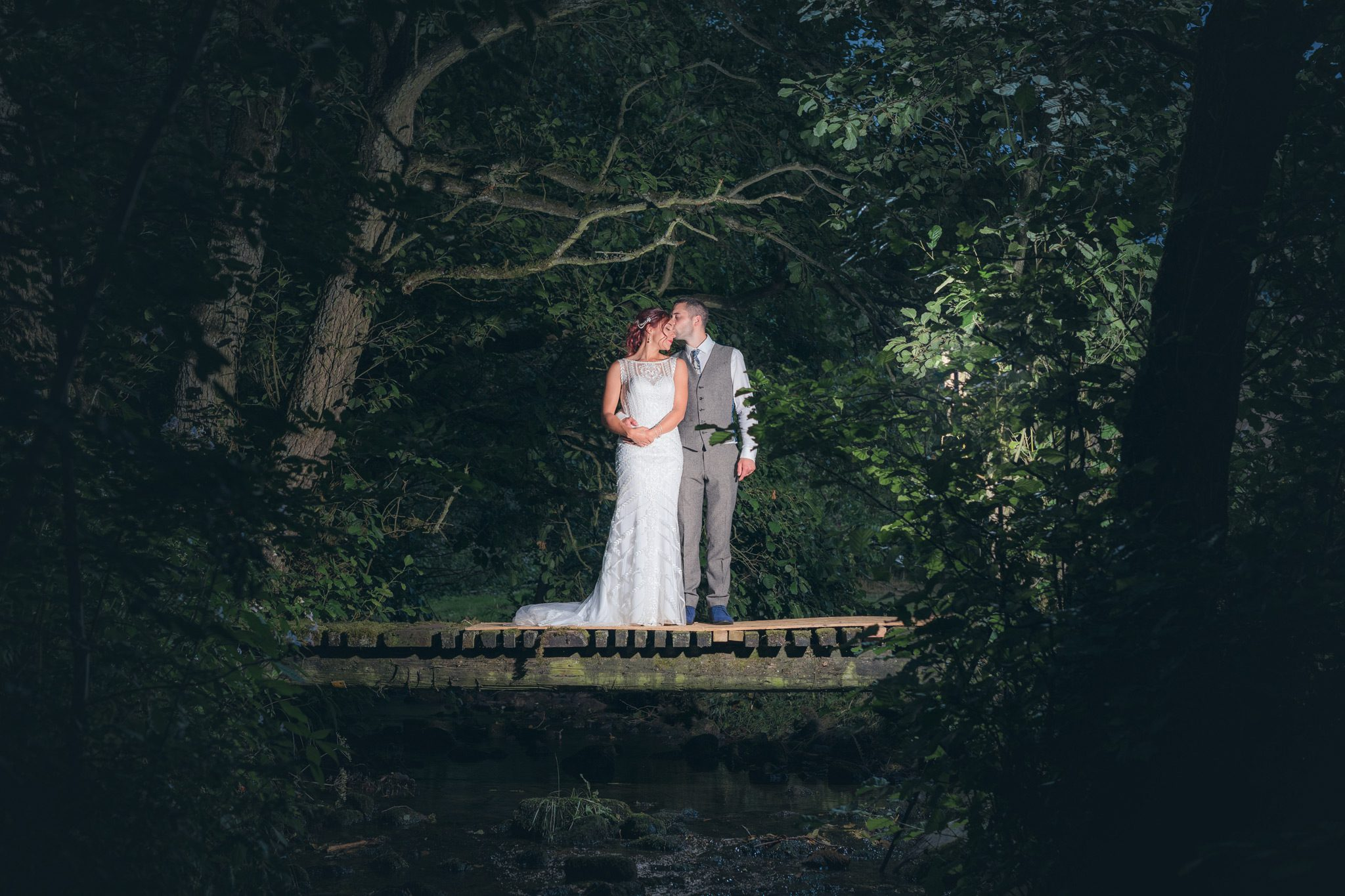 Couple stood on a wooden bridge in the Peak District