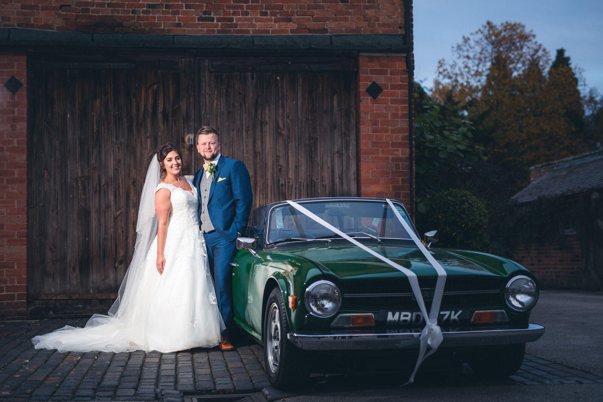 Couple with vintage car outside Yeldersley Hall
