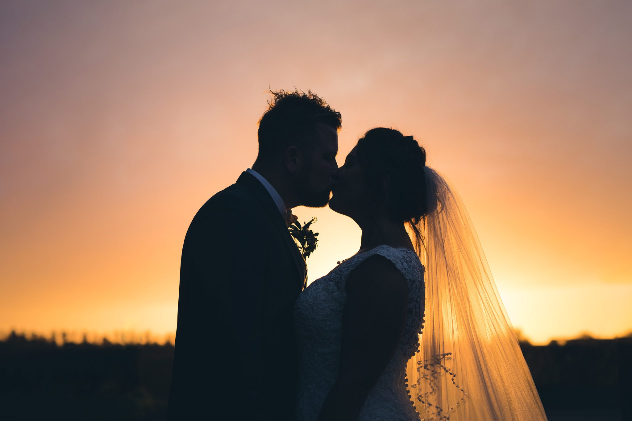 Couple kissing in the sunset