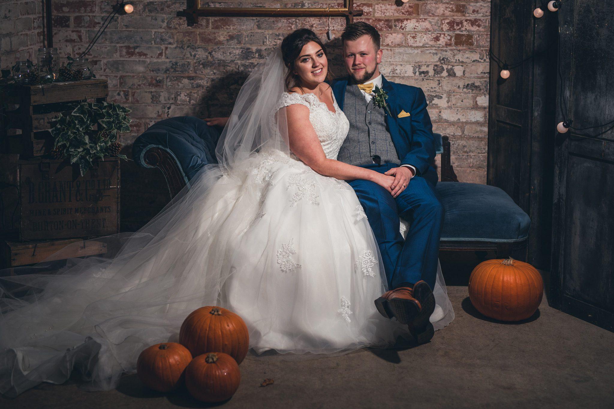 Couple with pumpkins at Yeldersley Hall