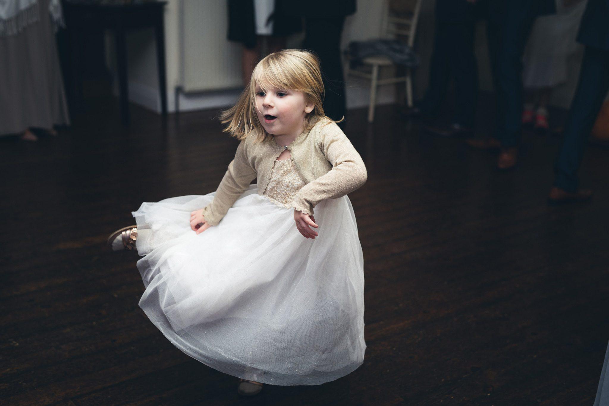 Flowergirl dancing at a wedding